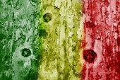 Mali Flag On A Weathered Grunge Background