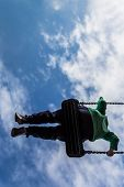 Young Boy Free In The Air On A Swing
