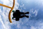 Silhouette Of A Boy On A Swing