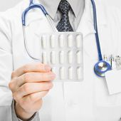 Doctor Holdling Pills In His Hand - Heath Care Concept