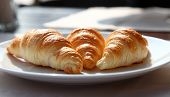 Tasty Croissants On A White Plate