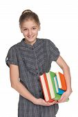 Happy Young Girl Holds Books