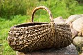Empty basket / Braided basket basket on green lawn