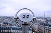 Binocular over top of building in Paris