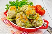 Cabbage Stuffed And Carrots In Pan On Napkin
