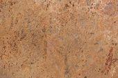 Pattern of a stone plate in ocher, beige, brown