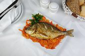 Fried Fish (dorado) On A Bed Of Vegetables