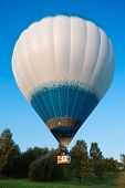 White balloon flying in blue sky