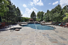 picture of swimming pool family  - Swimming pool of luxury home with large stone patio - JPG
