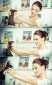 Beautiful, smiling red hair woman taking photos of herself with a camera