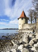 Lake Constance With Rocks And Tower