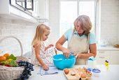 Cute Little Girl Baking With Her Grandmother