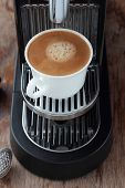 picture of brew  - Cup of freshly brewed espresso from a capsule - JPG