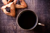 Hamantaschen cookies for Purim and coffee in ancient cup