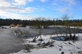 stock photo of ponds  - A view across a frozen pond at the Moss in Cowdenbeath - JPG