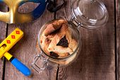 Hamantaschen cookies for Purim festival with wooden rattle and carnival mask