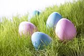 Many Decorative Easter Eggs On Green Grass