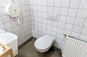 Opened door with toilet