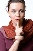 Woman Put Her Finger To Her Lips