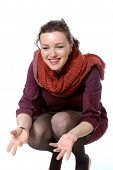 image of squatting  - Woman with scarf squatted and laughing to himself invites - JPG