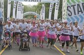 Happy Gaggle Of Color Run Racers Take Off