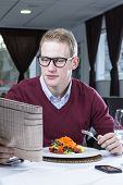 Businessman Eating At A Restaurant.
