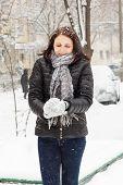 Girl Molds A Snowball