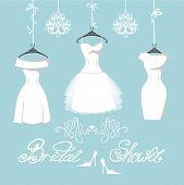 Set of  three bridal dresses hang on ribbons