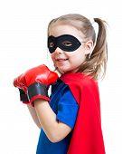 Superhero child wearing boxing gloves