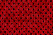 Close Up On Black And Red Heart Dots Woolen Texture.