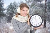 Beautiful Woman With Office Clock In Winter Forest