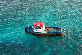 Red White And Blue Pilot Boat In Aqua Water