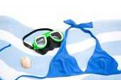 snorkel and shell on towel