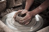 picture of molding clay  - Image of Artisan hands making clay pot - JPG