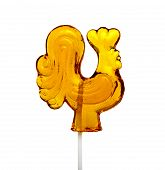 Sugar Lollipop In The Shape Of Rooster Isolated On White Background