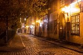 picture of stone house  - Covered with paving stones street in Old Riga Latvia at night - JPG