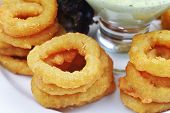stock photo of souse  - Fried onion rings with green souse on plate - JPG
