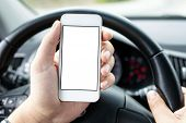 Driver In The Car Holding Phone With Isolated Screen