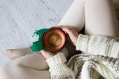 Cup Of Coffee In Woman's Hands, Top View