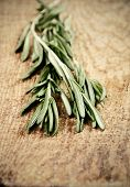 Toning Effect Sprigs Of Rosemary On A Wooden Board Closeup Vertical Low Angle