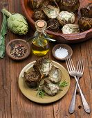 picture of artichoke hearts  - artichokes with spices on the wooden background - JPG