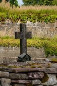image of graveyard  - Graveyard with stone cross at an old monastery ruin in Gudhem in Sweden. ** Note: Shallow depth of field - JPG