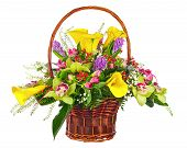 Flower Bouquet Arrangement In Wicker Basket Isolated On White Background.