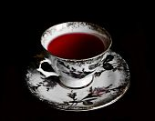 Cup Of Red Tea In Black Background