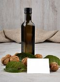 stock photo of walnut  - Image of walnut oil with walnuts and card