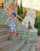 Child on the stairs of house