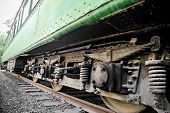 picture of train-wheel  - Detail shot with wheels and suspension system from an old train wagon