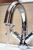Water Tap With Modern Design In Bathroom