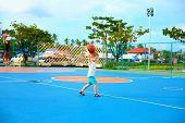 Young Boy Throwing Ball, Playing Basketball On Playground