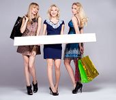 Three Young Girls Shopping.